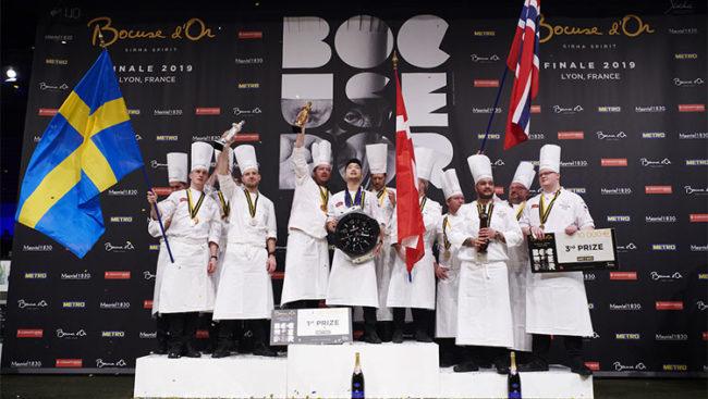 Finale Bocuse d'Or 2019. Sul podio le squdre vincitrici: Danimarca, Svezia, Norvegia (Photo: Dario Bragaglia © Mondointasca.it)