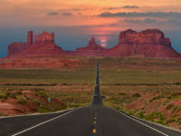 Scenic highway in Monument Valley Tribal Park in Arizona-Utah border, U.S.A.