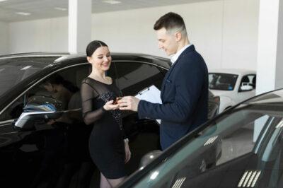 buyer-keys-new-car-showroom